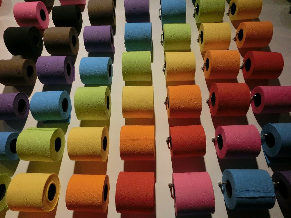 colorful rolls of toilet paper